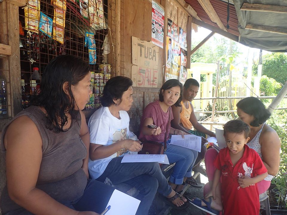 Head Researcher April Porteria interviews residents of a fishing community that will be affected by the tide embankment project. Fishers are worried their homes and livelihoods will be displaced because of the project.